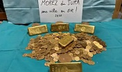 Gold bars and coins found stashed in old French house