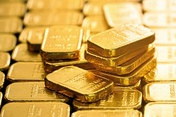 Gold down, dollar up as investors prepare for tapering